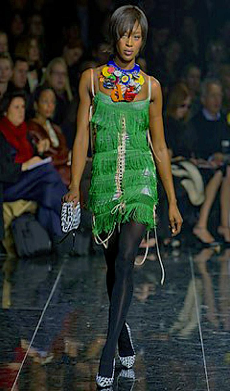 Dolce & Gabbana rare rich emerald green silk fringe dress worn on the runway by Naomi Campbell.  Inspired by the 1920's fun flapper dresses this one is beautifully designed with much attention to details.  Interior and exterior of light blue silk