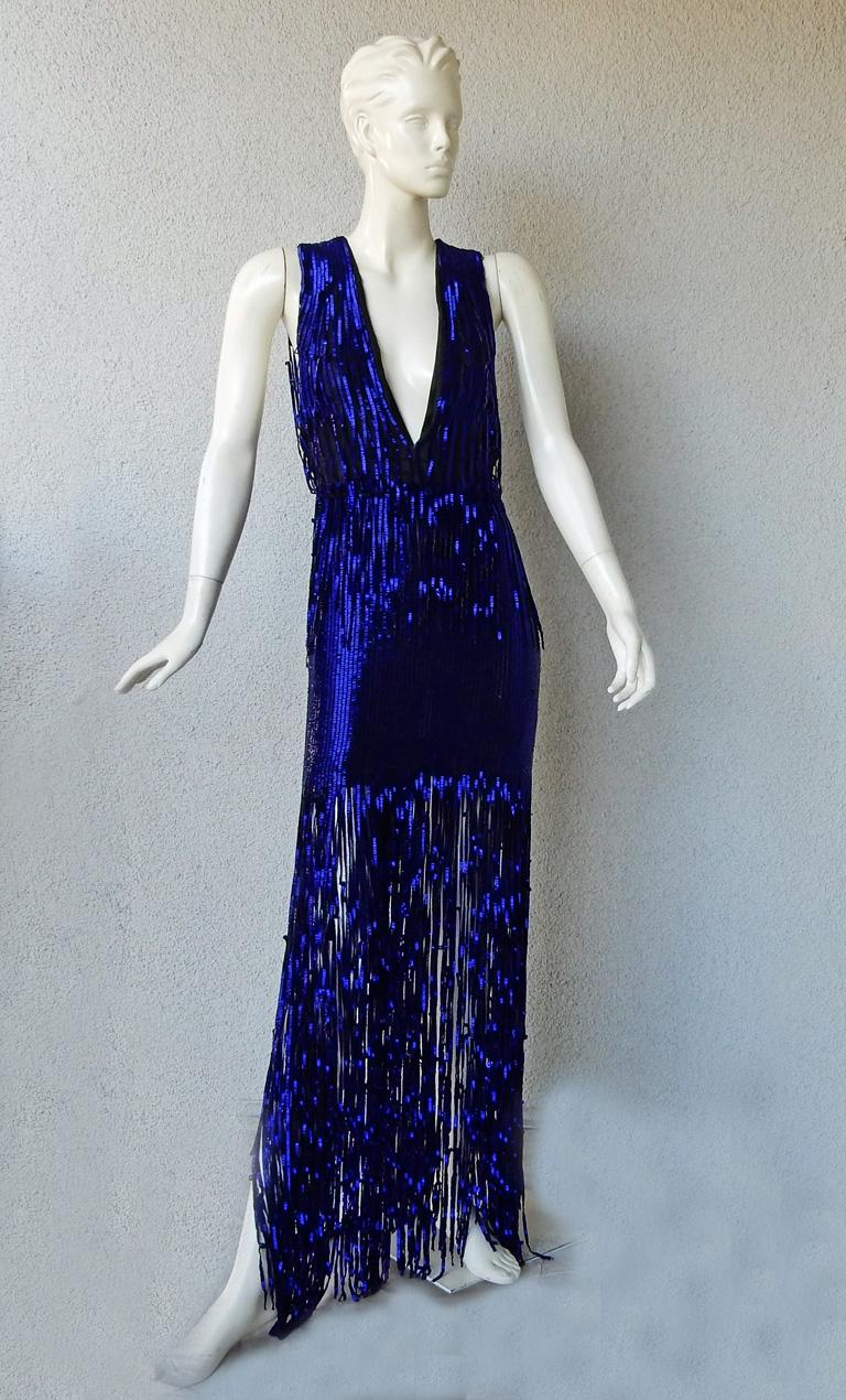 Brand new Tom Ford deco inspired hand beaded evening dress.   Boasts rich beautiful cobalt blue bugle beads all hand sewn atop black silk organza extending down to skirt featuring open work fringe to showcasing lots of leg.   Dress is 1 piece with