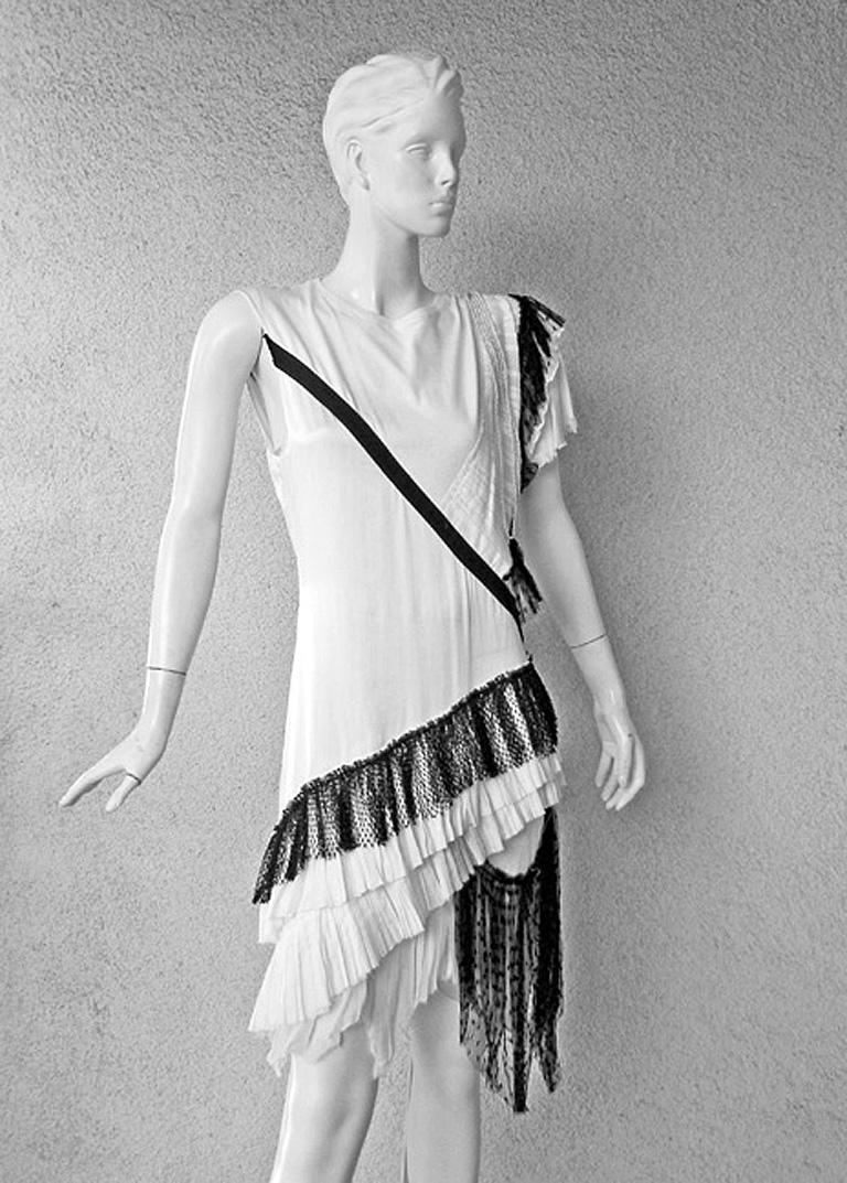 Balenciaga by Nicholas Ghesquiere 2001 Spring/Summer runway collection. This dress was photographed on the catwalk in white. The one being offered here is in the black and white combination.   Dress was written up in Vogue magazine as highly