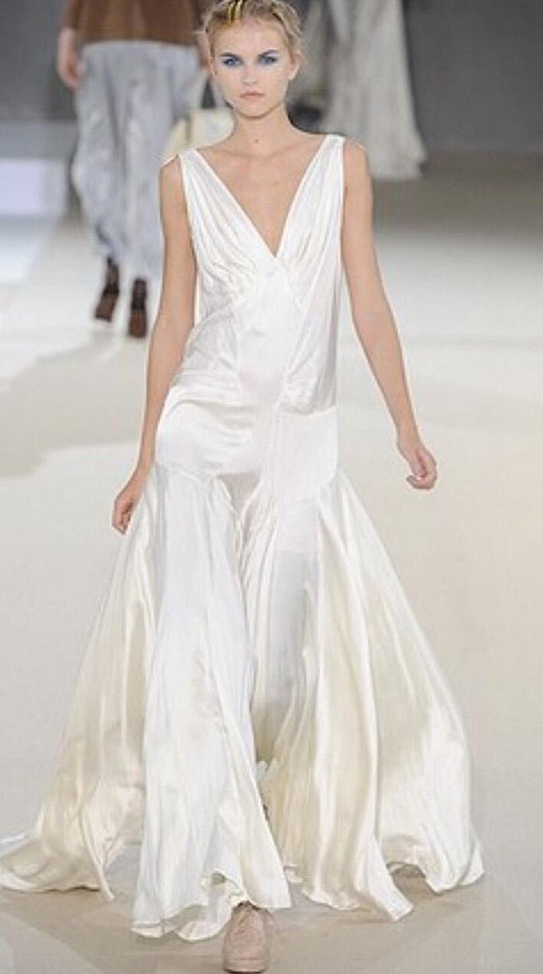 Jean Harlow 1930's inspired gown designed by Rochas.   Fashioned of off white silk charmeuse with plunging pleated neckline; chemise style bodice extending into a full graceful drape skirt.  Unlined.  Over- the-head entry.  As shown in runway