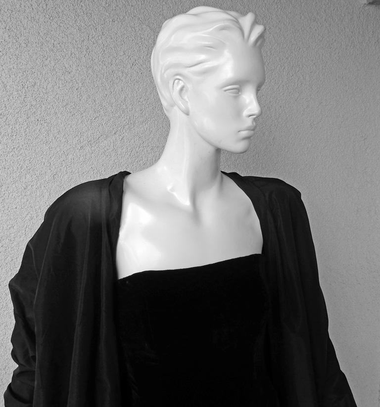 Rare and dramatic Jean Paul Gaultier 2 in 1 gown with attached evening coat/evening dress.    Featured on the runway of the 2012 F/W collection.  Fashioned of black velvet in a strapless sheath with thigh high slit. Long evening coat is attached to