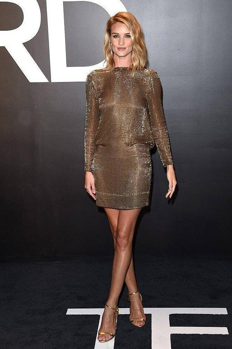 Dramatic sienna bronze hand beaded evening dress by Tom Ford.  As seen on model, Rosie Huntington-Whiteley.  Fashioned of Italian silk with twinkling glass bugle beads throughout.  Boasts a bateau neckline with stunning draped back.  Simple sheath