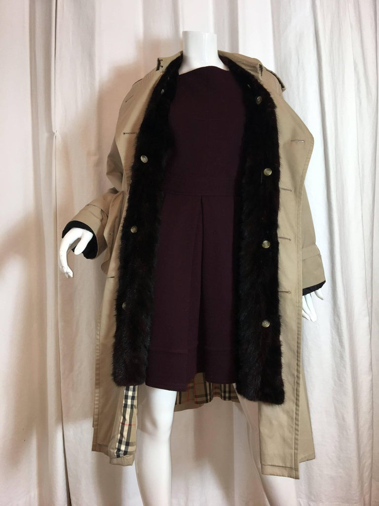 Burberry Tan Double Breasted Trench coat with removable Button-In Fur Lining.  Size estimated as a US6.  Measurements listed as its an oversized fit: Shoulder to Shoulder 16.5