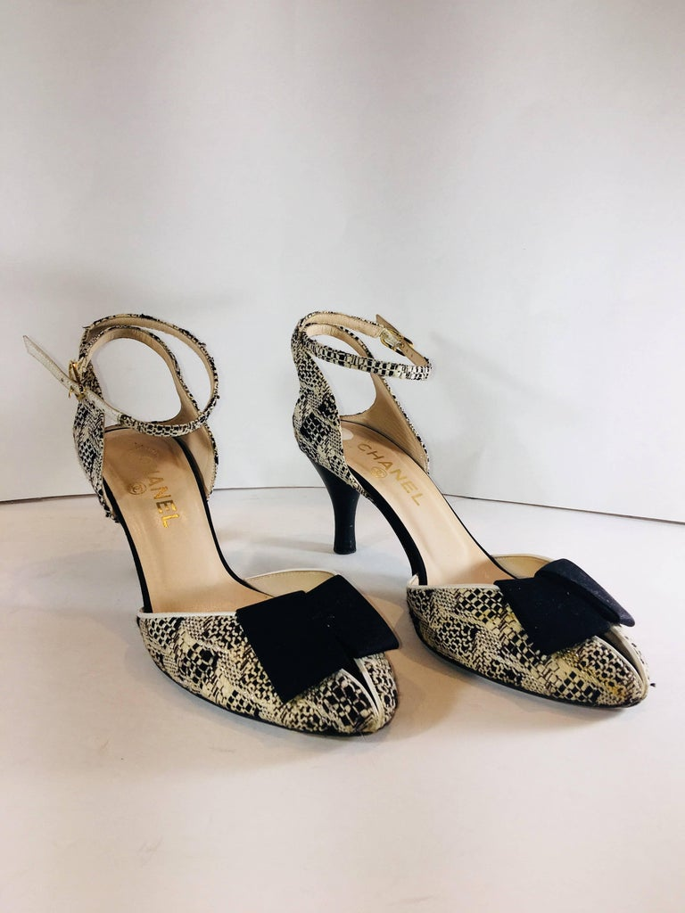 Chanel Round Toe with Ribbon Bow Accents at Toe and Ankle Strap in Black and White and Metallic Tweed Pattern and Gold Hardware.