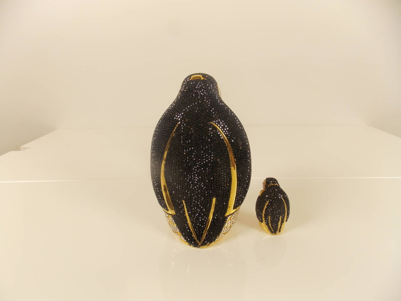 Penguin clutch with gold chain strap, small penguin box inside and comb.