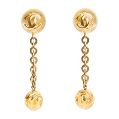 CHANEL  Gold and Lucite Drop CC Logo Earrings