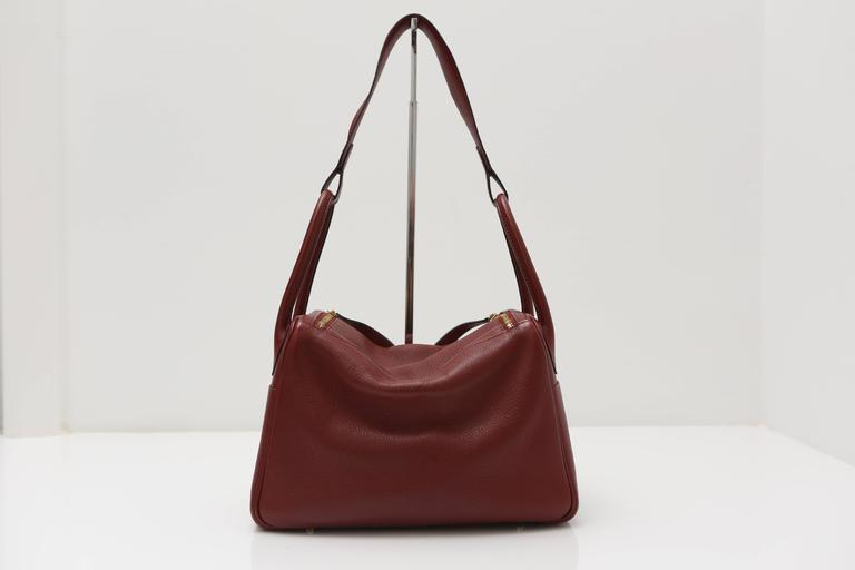 4c359e2f7bb The Hermes Lindy Bag is roomy enough to store all your essentials and it can  be. Brown Hermes Lindy Burgundy Bag with Gold Hardware For Sale