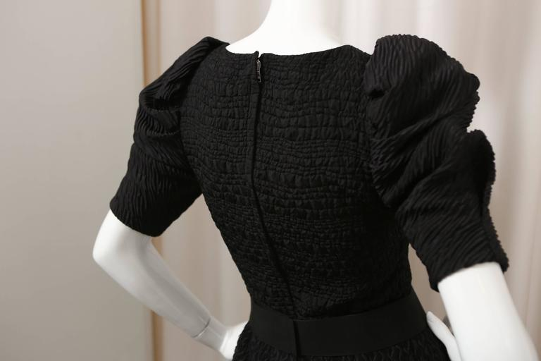 Black silk/wool blend puff-sleeve dress with attached belt.