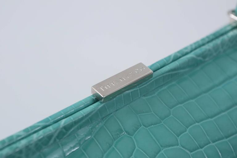 "Tiffany & Co. ""Laurelton"" crocodile handbag in Tiffany Blue with single top handle, silver hardware and front pocket.  