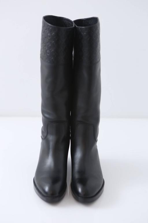 f13fb471a337 Louis Vuitton riding style boots with Embossed monogram pattern at top.