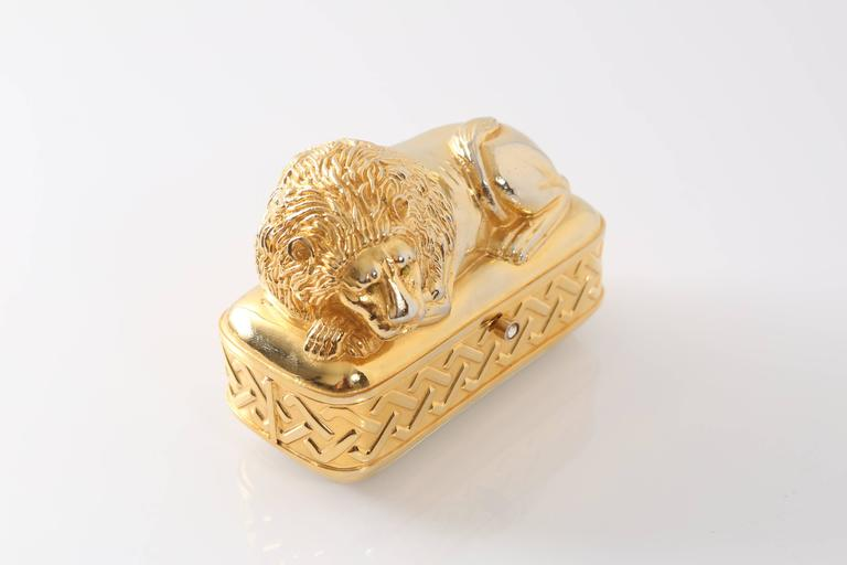 Vintage Judith Leiber gold lion clutch with green swarovski crystal eyes and a sliding clear swarovski crystal closure.  Leather lined interior and bottom leather exterior.