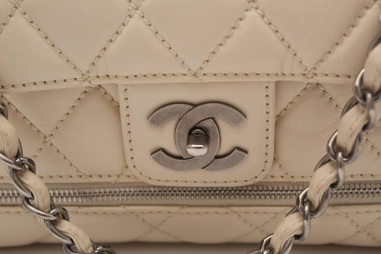 bca188d67b9 This Chanel Paris/New York (PNY) Expandable Flap Bag is made of Distressed