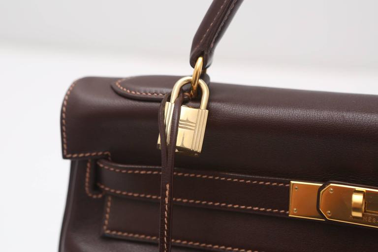 "Hermes brown leather ""Kelly"" handbag with Gold HW.  Letter stamp 'X', Hermes lock and keys, and shoulder strap.  