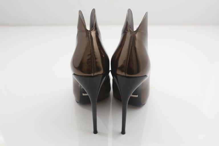Gucci Tie Up Metallic Bronze Booties  In Good Condition For Sale In Southampton, NY