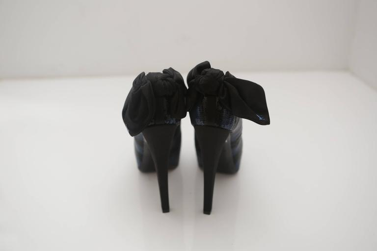 "Louis Vuitton 6"" peep-toe platform sequin pumps with black bow with ""LV"" monogram."