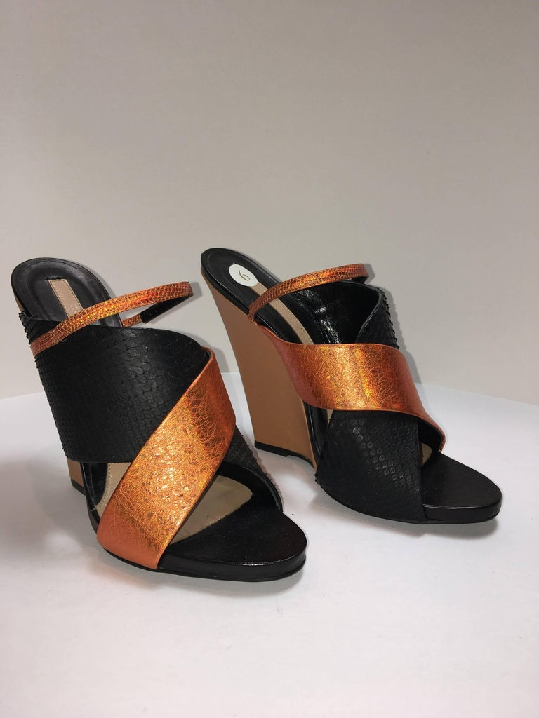 Criss-Cross strap wedges with contrasting metallic and snake print design. Two thick straps with a complimenting third narrow strap.