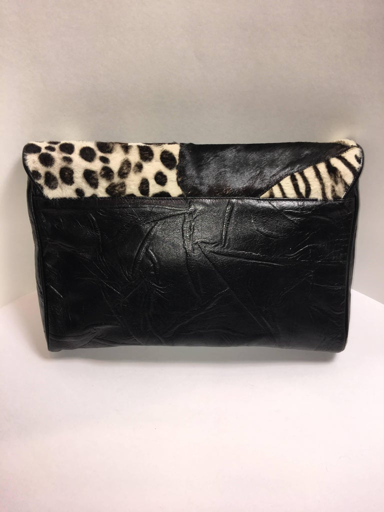 Carlos Falchi Oversized Clutch with Black/White Animal print. Made of leather and animal hair.