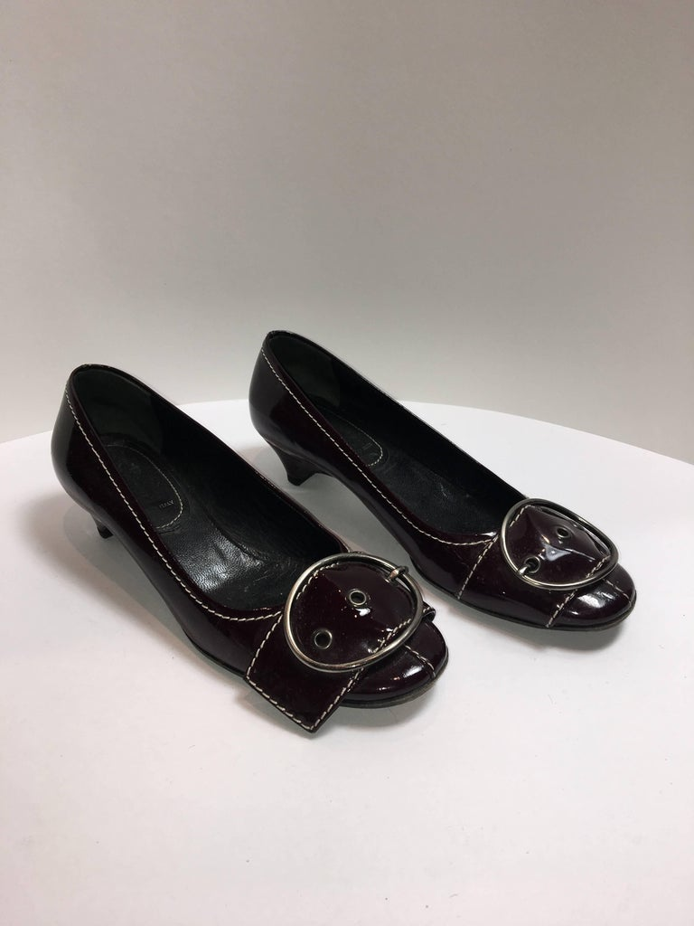 MiuMiu Dark Red Patent Leather Kitten Heel with big buckle detail on toe.