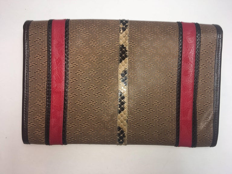 Carlos Falchi Leather Clutch with Fold Over Flap Closure, Multi Colored Aztec Pattern, and Leather Knotted Strap.