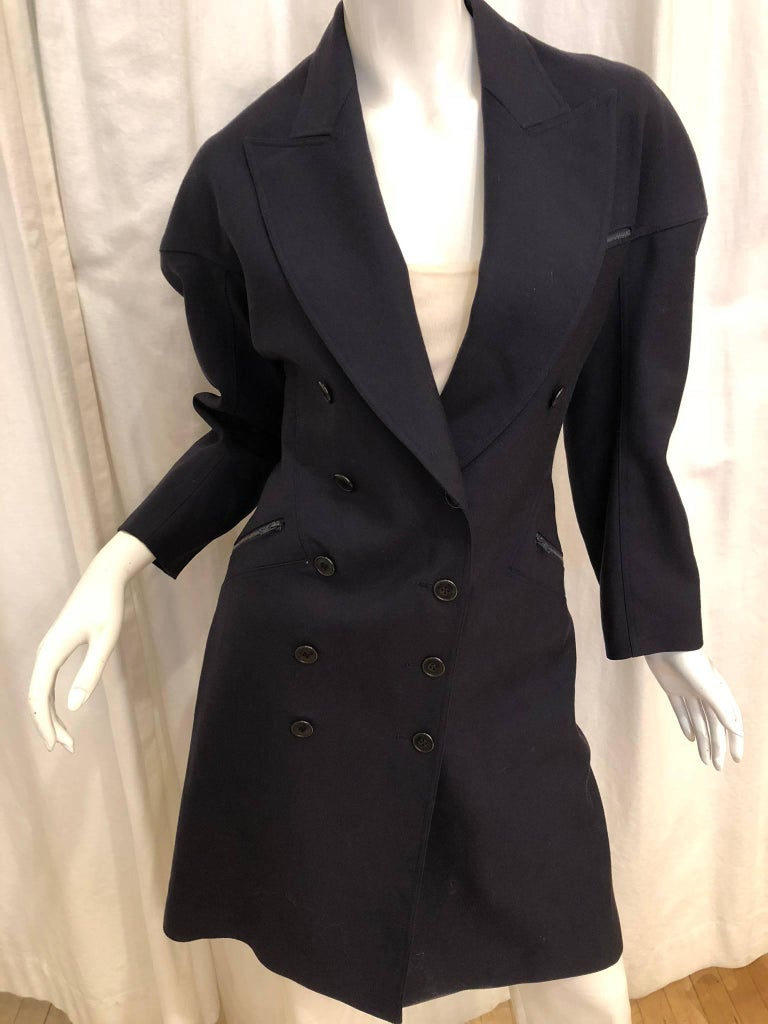 Alaia Double Breasted Coat with Triple Zipper Pocket and Peak Lapel Collar.