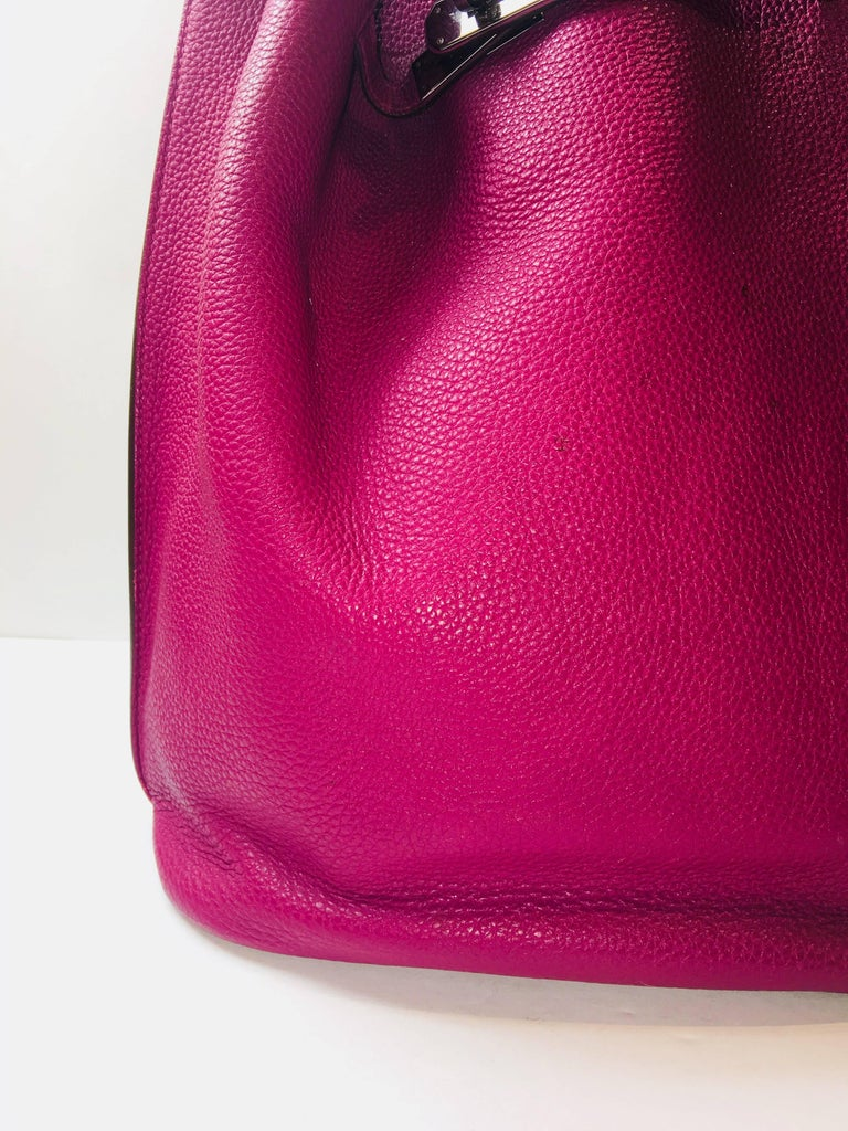 Hermes Plum So Kelly Leather Bag with Brown Trim and Silver Hardware. Retails $7500