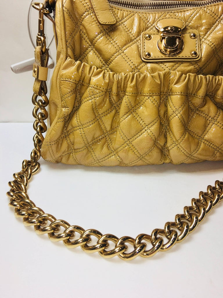 Marc Jacobs Beige Patent Leather Quilted Bag with Single Leather Strap, Wide Gold Link Strap, Zipper Top, Side Pocket.