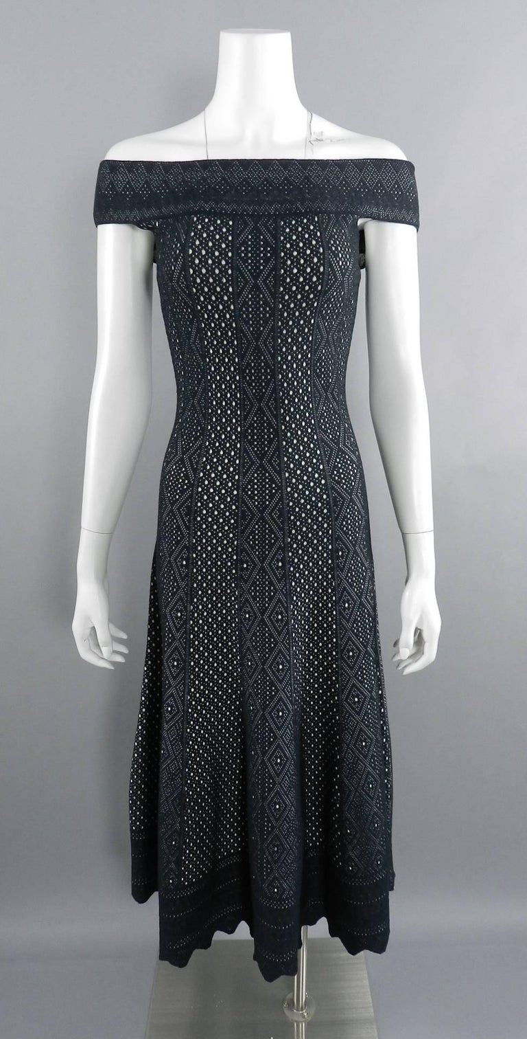 Alexander McQueen Black Lace Jacquard Knit Off Shoulder Dress.  From the Spring 2017 collection.  Stretch knit jersey in black and ivory with scalloped hem.  Garment has no zippers or closures and is a pull-over. Original retail $2165 USD. Tagged