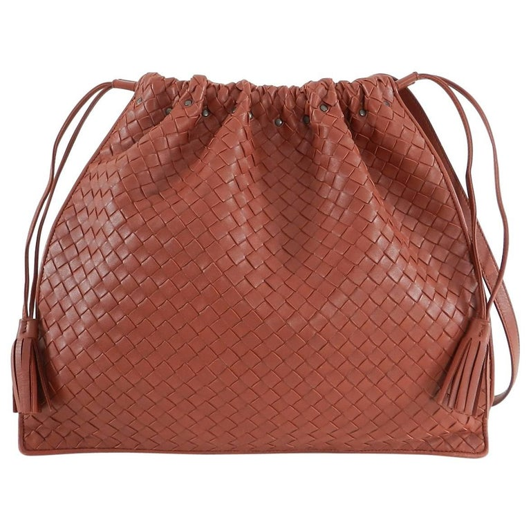f20e165c6b Bottega Veneta Brick Red Intrecciato leather Drawstring Bag. Dark matte  gunmetal stud and buckle detail