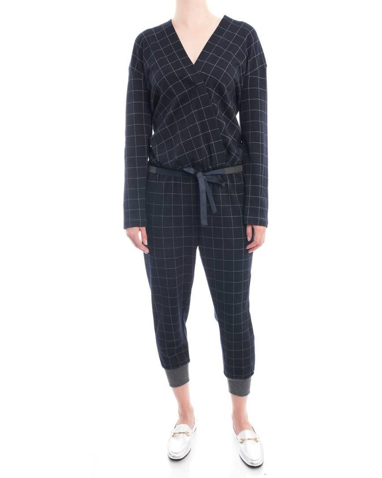 "Brunello Cucinelli Navy Wool Check Jumpsuit with Grey Cuffs. Wrap design bodice, elastic waist with matching silver metal beaded sash belt, grey cuffs. Marked size M (USA 6/8). Model is 5'10"" tall. Garment bust measures 42"" and is recommended to be"