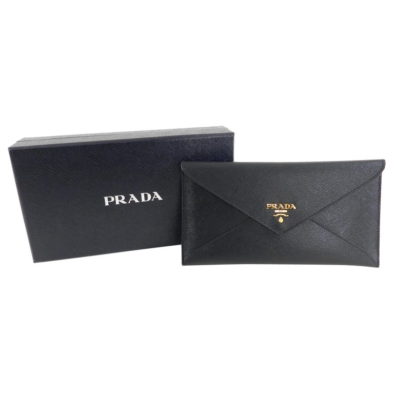 ed18d272649f Prada Black Saffiano Leather Envelope Wallet. Slim design with gold logo  front, snap closure
