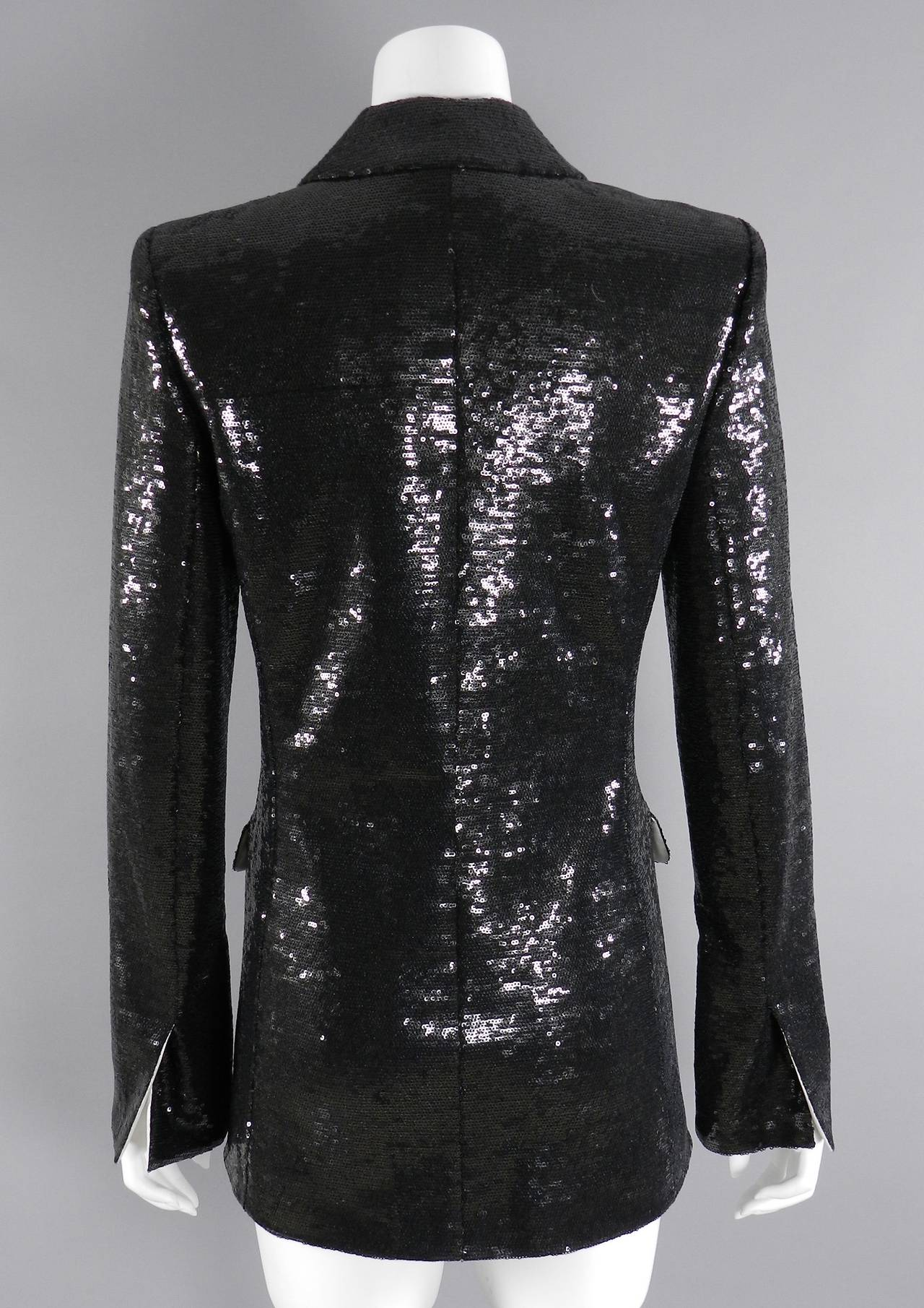 """Up for bids is this authentic long tailed tuxedo jacket from about It measures 18"""" across the front of the chest, armpit to armpit, to fit a 36"""" chest."""