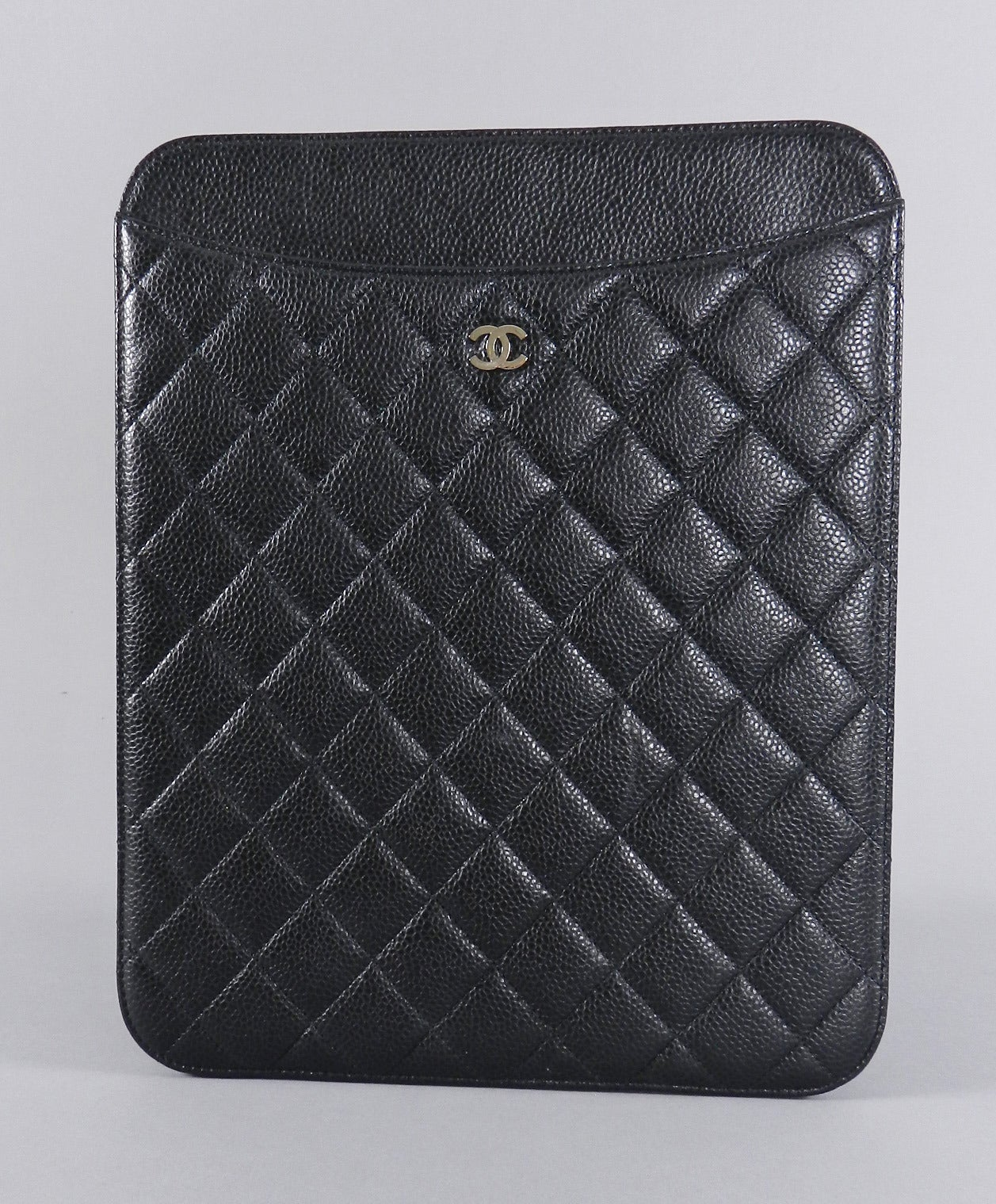 "Chanel black caviar ipad case with silvertone CC. Soft burgundy lining. Excellent clean previously owned condition with no flaws. Original card or duster is not present.  Date code 15 series for year 2012.  Measures 10.5 x 8.5"".