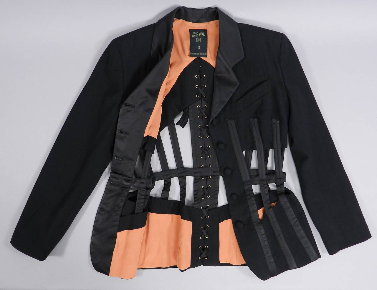 """Jean Paul Gaultier iconic 1989 black corset cage jacket. Excellent vintage condition. Tagged size FR 44 (approximate USA 10).  Actual garment bust is 38"""" and recommended for about 36"""" bust person, waist to fit 30"""", garment hip 42"""". Shoulder seams"""
