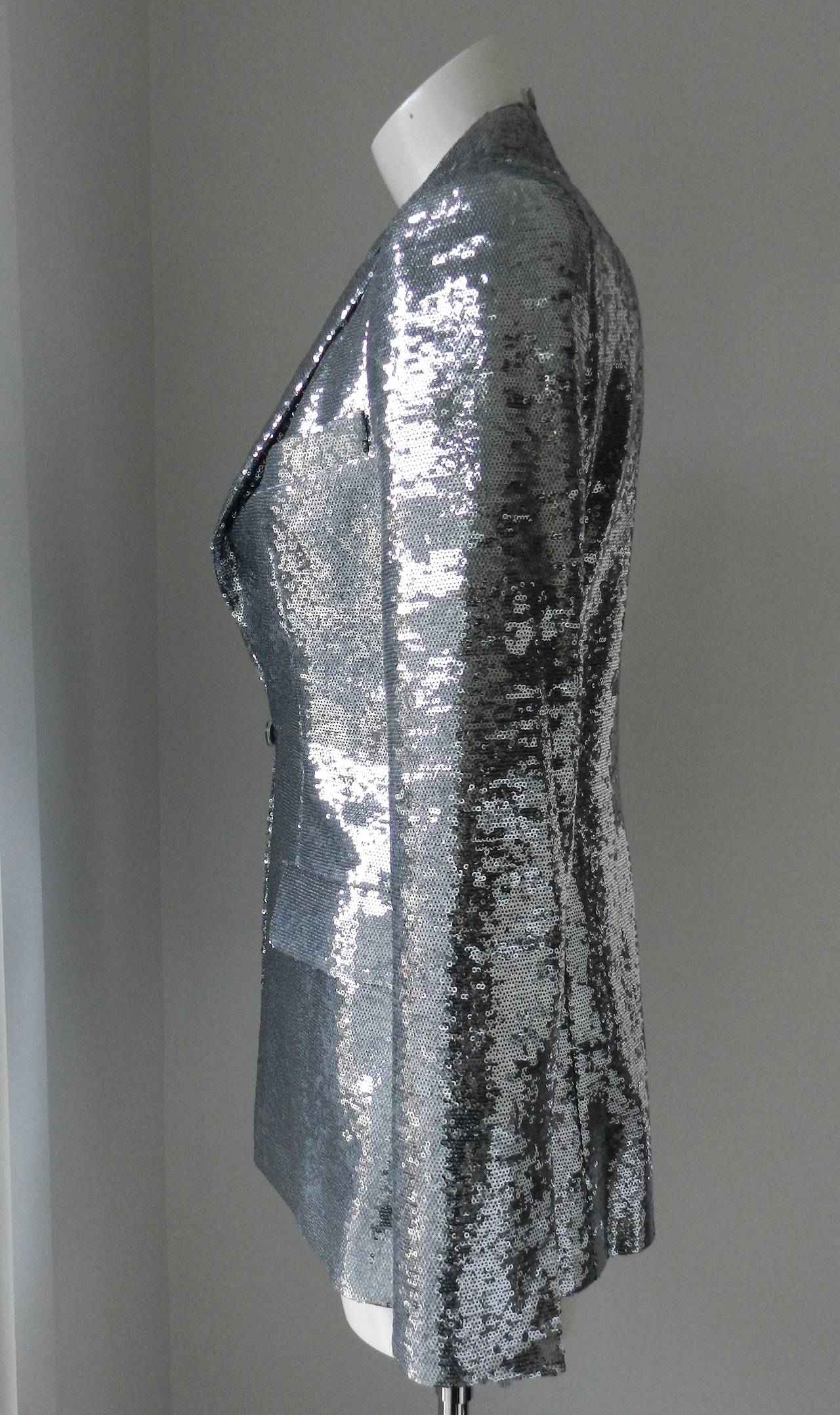 "Chanel 2009 Resort runway collection jacket. Fully covered in silver sequins and lined in silk. Tagged size FR 38 (USA 6). To fit 34"" bust, actual waist is 32"", and 38"" hip. Shoulders 15"", 25"" sleeve, 28"" back neck to hem. 98% poly and"