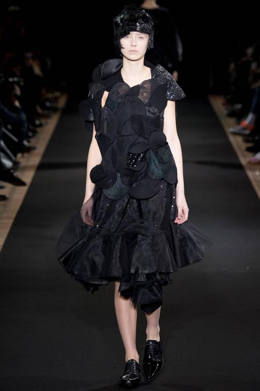 """Junya Watanabe Comme des Garcons Fall 2014 runway skirt. Brand new with tags - never worn - retail price tag of $1750+. Wrap style design that fastens with one button and then ties with a satin sash. Tagged size M and fastens at 26"""" but button can"""
