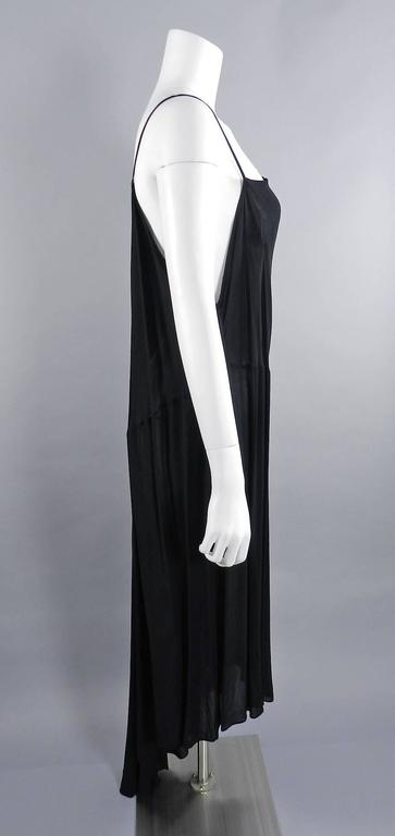 Yohji Yamamoto vintage circa late 1980's sheer black long dress. 100% rayon.  Loose and free pull-over design with no zippers or fasteners.  Asymmetrical hemline, one strappy shoulder, and one low plunging side. Shoulder to hem of longest part of