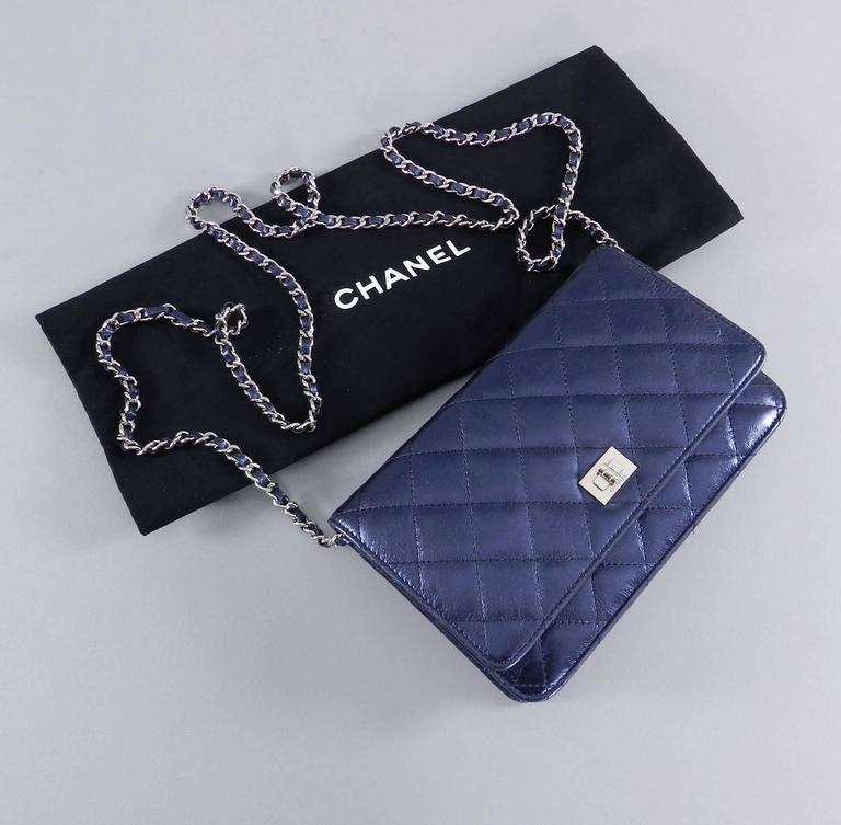 ecc2a00a9799 Chanel navy metallic quilted wallet on a chain with silver hardware.  Excellent pre-owned