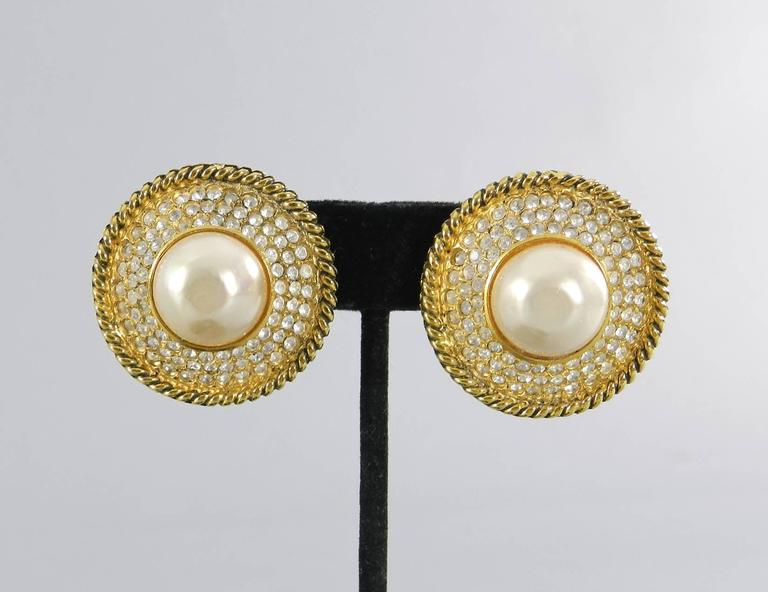 "Vintage 1980's Chanel 100% authentic faux-pearl and rhinestone button clip on earrings. Excellent vintage condition. Clips work well and each earring measures about 1.25"" across.