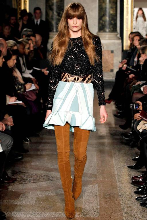 Emilio Pucci fall 2013 runway collection evening top. Silk body is completely decorated with black glass beads and prong-set swarovski crystals. Pierced cut-out design.  Fully lined with silk. Has a silver tone metal zipper down centre back and