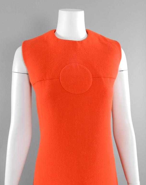 Pierre Cardin vintage late 1960's orange wool mod dress. Centre back zipper, sleeveless design, op-art circular inset at front neck, banding at dress hem. Fully lined. Excellent drycleaned vintage condition. Overall approximate modern size USA 8/10.