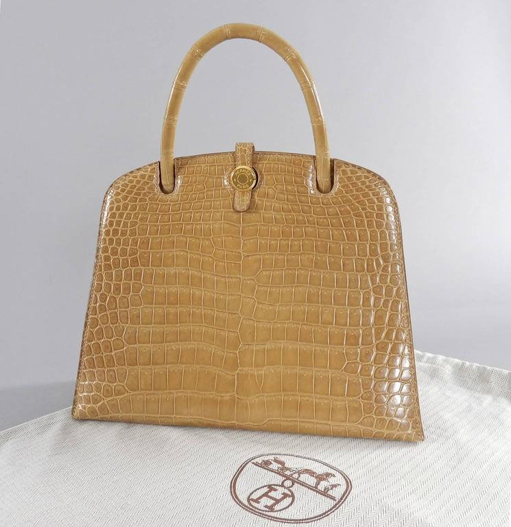 Hermes vintage 1998 beige crocodile dalvy 25cm bag.  Porosus crocodile marked with ^ symbol.  Date stamp B in square for 1998.  Excellent clean condition. Appears to have been stored and unused.  