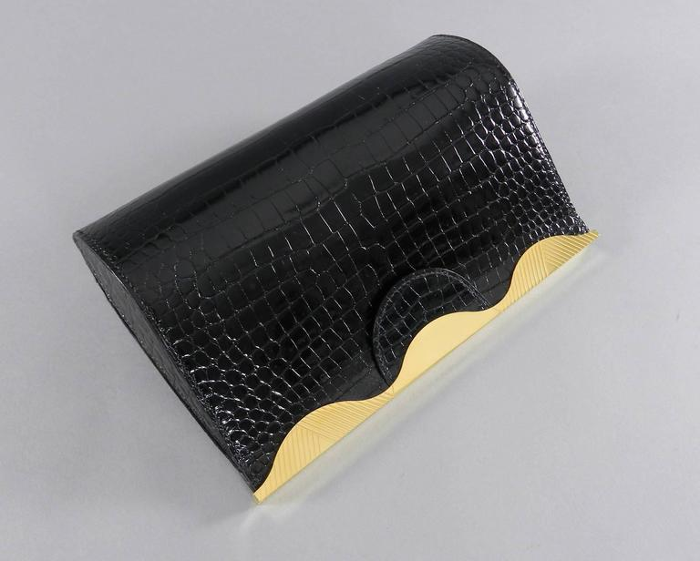 Women's Hermes Vintage 1998 Limited Edition Black Crocodile Clutch with Gold Frame For Sale