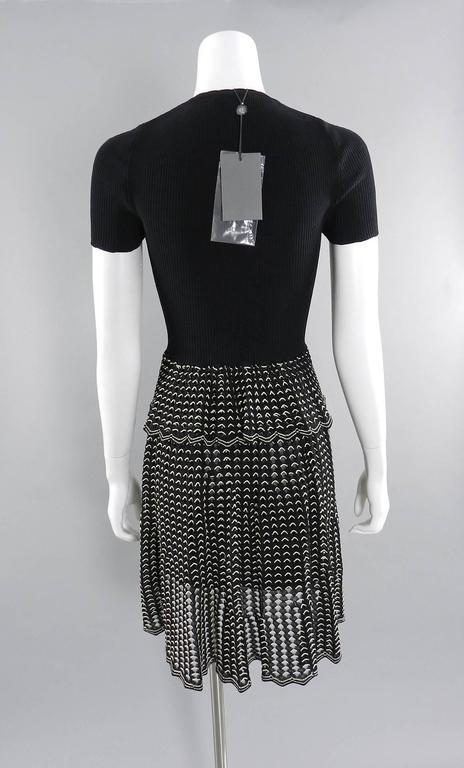 Women's Alexander McQueen Black Ribbed Stretch Knit Peplum Dress For Sale
