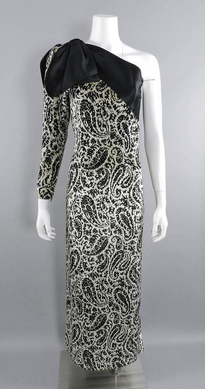Lanvin circa early 1980's Vintage Panne Velvet 1 Shoulder Gown.  Paisley pattern velvet gown with thick black silk satin shoulder bow. Metal side zipper, fully lined, leg of mutton sleeve with zippered cuff. Approximate overall size 6 /8. Garment