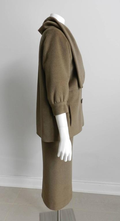 """Nina Ricci vintage early 1960's cashmere skirt suit. Mossy green or brownish olive color.  Velvet waistband on skirt and acetate lined. Skirt waist measures 31"""" (Unsure if original waistband was replaced with velvet waistband to allow for"""