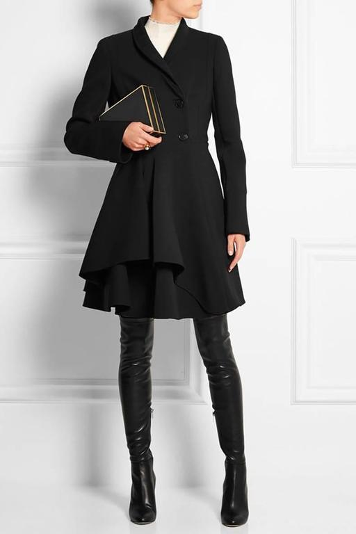Alexander McQueen Black Scuba Coat with Asymetrical Ruffle.  Pre-fall 2015. Original retail $4000+ . Princess Cut, double breasted, top stitch detail, 2 side hip pockets. Unlined body but lined at upper interior.  Excellent pre-owned condition -