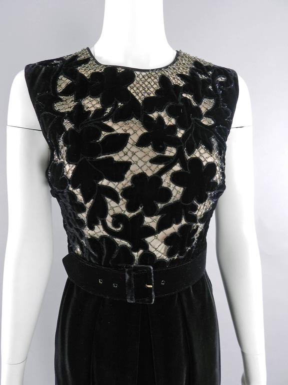 Valentino Black Velvet Cocktail Dress. Bodice has a cut-out lace design backed with net fabric and nude lining decorated with rhinestones. Centre back zipper, sleeveless design, wide belt. Excellent pre-owned condition.  Tagged size IT 44 (USA 8).