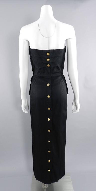 Chanel Vintage 1987 Black Strapless Cotton Dress with Wheat Buttons.  Boned corseted bodice, fastens down back with gold buttons, and has peplum side pockets. Excellent vintage condition. Size tag has been removed but is a FR 40 (USA 8). Garment