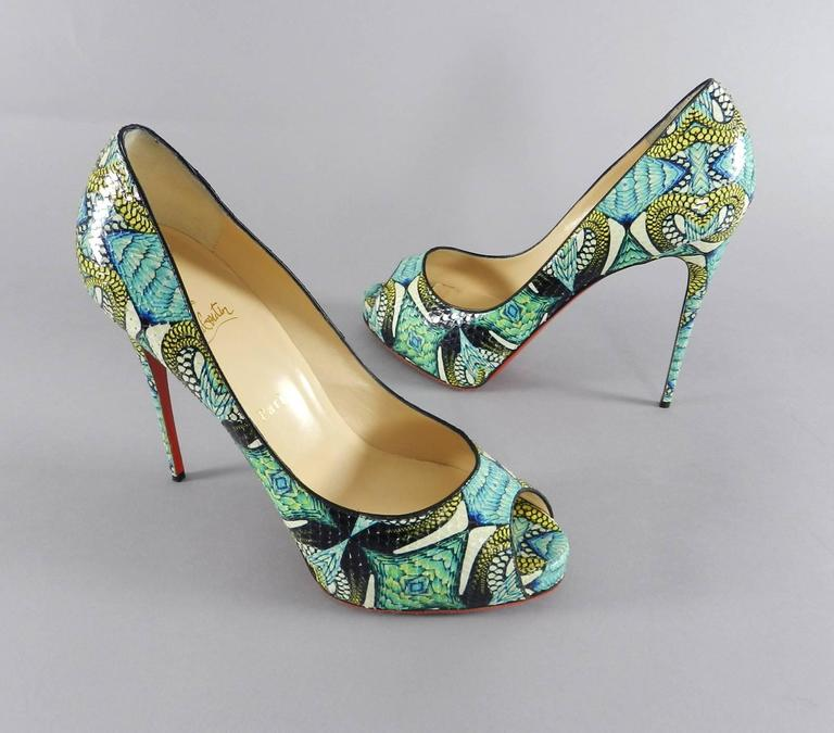 Christian Louboutin Green Python Inferno Platform Heels. Grips have been added to bottoms but these are unworn. Size 41. Heel height 130cm. Includes red dusters.  We ship worldwide.