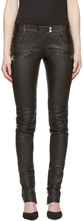 Balmain Black Leather Biker Motorcycle Skinny Jeans / Pants.  This style is still in stores selling for $3100+. Size FR 36 (USA 4). Gold metal ankle zips, ridged knees, gold lion head snaps.  Excellent pre-owned condition - worn once if at all -